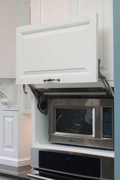 Want your kitchen to look luxurious? Keep it streamlined with hidden cabinets. -- Choose Waypoint Cabinets in Thermofoil White at Hood's Home Center Gulfport.