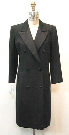 1990s Daytime Dress: This tudexo-style dress was designed by Yves Saint Laurent in 1990. The idea of unisex-style clothing was a huge trend in the 1990s, and this tuxedo-like dress showcases a woman's ability to wear more gender-neutral garments.