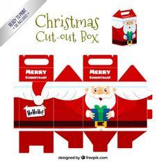 Cajas con motivos navideños que pueden servir para envolver regalos o para llenar de chocolatinas o caramelos y ser...