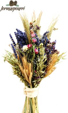 Beautiful dried flower bouquet. Made out of Provence lavender, oats, wheat, larkspur, marjoram, helichrysum and gypsophilia. Tied with raffia and scented with 'Lavender Fieds' oil.