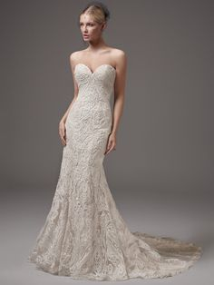 Beaded lace sweetheart neckline fit and flare wedding dress. | Maggie Sottero | Style: HADLEY