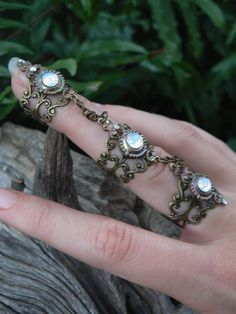 slave ring triple armor ring claw ring wite opal glass nail ring goth victorian steampunk moon goddess pagan witch boho gypsy style by gildedingypsy on Etsy Viktorianischer Steampunk, Steampunk Fashion, Steampunk Rings, Steampunk Outfits, Gothic Rings, Steampunk Wedding, Gothic Wedding, Gypsy Style, Boho Gypsy