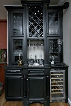 Black cabinets--glass on top, but with backsplash & fridge/microwave, too!