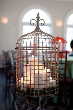 Pairing lots of Pillar candles in different sizes and choosing unique holders can create an amazing centerpiece! Bird Cages, Candle Lanterns, Candle Decorations, Candleholders, Pillar Candles, Centerpieces, Deco Table, Bird Houses, Sweet Home