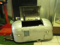 This scale model Airstream trailer is actually a hand made cooler about 3 ft.long.It is on display in the lobby of the Airstream Trailer Co.service center in Jackson Center,Ohio.