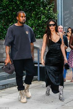 The couple that dresses together: The power couple were dressed fiercely in their similar all black ensembles