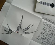 swallows...maybe a flower instead of a letter...