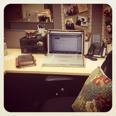 A very cute cubicle -- I love the burlap & lace runner down the cube wall, with all of the pictures tacked to it!