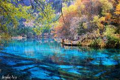 """Beautiful Autumn in Jiuzhaigou Autumn scenery in Jiuzhaigou is scenic and unique in China and around the world. Jiuzhaigou (northern Sichuan, China) means 9 villages valley of Tibetan. It was dubbed the """"paradise on earth"""".  It has 108 lakes with turquoise water. Peaks with elevations ranging from 2,000 – 4,000 meters covered with white snow. Jiuzhaigou was recognized as a world cultural heritage by UNESCO in 1992."""