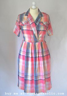 This dress is made of a textured seersucker / cotton that has wrinkles and crinkles in the fabric – perfect for drip – drying if you are in a hurry or don't enjoy getting out the ironing board!  The colors of the check are salmon pink, yellow, grey with a slight bit of blue on a white background Browse and buy https://www.etsy.com/uk/listing/203567334/1980s-pink-checked-dress-vintage-british?ref=related-7