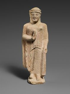 Limestone woman Period: Archaic Date: 6th century B.C. Culture: Cypriot Medium: Limestone Dimensions: Overall: 7 1/2 x 2 1/2 x 2 in. (19.1 x 6.4 x 5.1 cm) Classification: Stone Sculpture Credit Line: The Cesnola Collection, Purchased by subscription, 1874–76 Accession Number: 74.51.2547