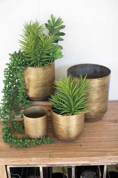"""Perfect for succulents or herbs, this set of four metal flower pots has the perfect patina for an elegant addition to your garden... or use them as organizers to elevate the look of your home office. large 6""""d x 7""""t succulents not included"""