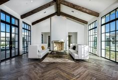 Contemporary Living Room with Charlestown Oak - Mocha, High ceiling, stone fireplace, Hope's Steel Windows & Doors, Carpet