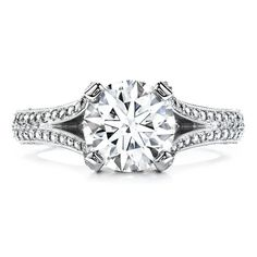 A romantic design of The World'€™s Most Perfectly Cut Hearts on Fire diamond is set on a beautiful split shank diamond band.