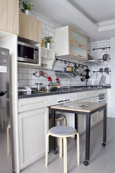 The Kitchen in This Tiny Apartment Is Smart Yet Crazy — Tiny Kitchens Great way to get extra prep space or dine in option when not enough room for a full time island Kitchen Furniture, Kitchen Interior, New Kitchen, Kitchen Dining, Kitchen Decor, Kitchen Ideas, Dining Table, Furniture Making, Kitchen Storage