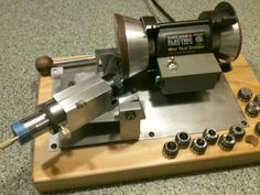 Motorized 4-Facet Bit Sharpener by Rodger Young -- Homemade motorized 4-facet bit sharpener constructed from aluminum, wood, and an off-the-shelf sharpener. http://www.homemadetools.net/homemade-motorized-4-facet-bit-sharpener-2