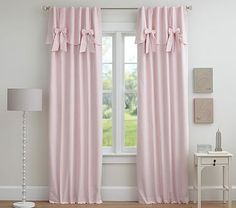 Inspired by a pretty ball gown, this window panel has an attached valance which is the perfect blend of sweet and stylish.