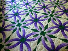 Purple and green double wedding ring quilt