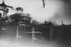 Disaster: The steamship Europa of 1930, consort of the Bremen and dual flagship of the Norddeutscher Lloyd (North German Lloyd), burns during her fitting out period. 1929. Image courtesy the private collection of John Cunard-Shutter.