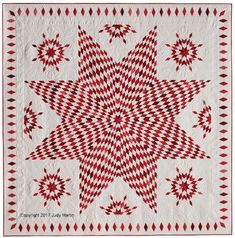 This classic red-and-white beauty is a strip-pieced pattern from Singular Stars: Judy Martin's Book of Lone Star Quilts.