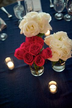 The Emerald Ballroom at The Madison Event Center Pink and white roses Wedding centerpiece Winter wedding Navy blue wedding decor