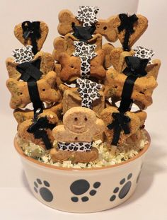 Dog biscuit treat dog gift basket in green bowl with paw prints ...