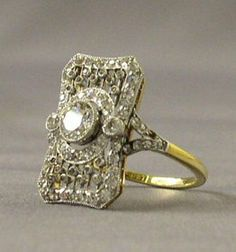Found in a Titanic expedition - Handmade platinum, 18k gold, and diamond ring. The gallery design gives it a three-dimensional depth as it highlights the Edwardian love of jewelry in imitation of lace.