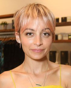 *All* the stars are going pink, like Nicole Richie here. Both sweet and a little punk rock, pastel dip-dyes will be an unexpected pop of pastel during the colder months.