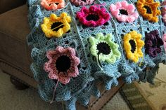 Priscillas: The Border..a row of sc, two rows of half double crochet , and then 3 half double crochets in each around makes a soft ruffled border