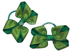 Emerald green glitter hair bows on thick bobbles - www.dreambows.co.uk #greenbows #hairbows #girlshairbows #hairaccessories #hairbobbles #glitterbows