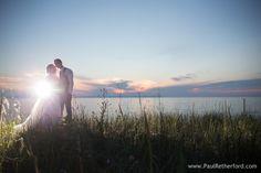 sunset at leland wedding photo by Paul Retherford Photography in Leelanau peninsula #nomiweddings #leland #lakemichigan #beach
