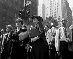 People in Times Square watch the news ticker on the New York Times building on D Day 1944