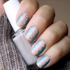 A shiny metallic base coat gives this fun nail design extra dimension. Taryn Multack of Miss Lady Finger started by painting all nails with a rose gold metallic polish. Once dry, use a dotting tool—the end of a Q-tip or toothpick will work in a pinch—to create the honeycomb layer. Place a few drops of a baby blue and a pale pink nail polish onto a paper towel, dip your tool so it's lightly covered, and place dots in a row on your nail. Finish with a clear topcoat for added sheen.