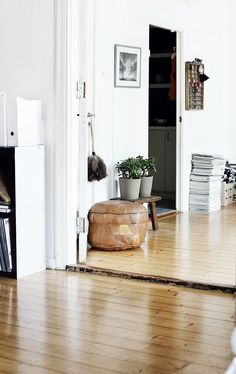 tan leather pouf in the entryway