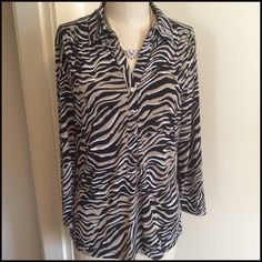 Nice Zebra Top Pretty Pullover Zebra top with a nice stretch. The sleeves are 3/4 in length. The neckline goes down to a v neck with a set of  shinny sliver buttons that do open. Does not go all the way down to hem. See Photos. The bottom hem is straight. 95% Polyester 5% Spandex  Machine wash cold/dry low  Bundle and Save Alfani Tops