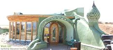 Building a completely sustainable home from recycled materials was key for this design.  Find out more at Earthship.