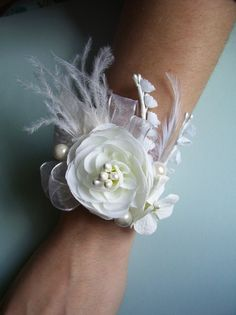 """""""I love unique corsages. Feathers  pearls are so elegant"""""""
