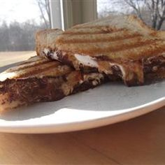 Peanut Butter Cup Grilled Sandwich Allrecipes.com This would work great in the pudgy pie maker over a fire