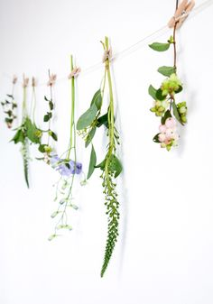 6 Decorations to Hang on Your Wall (That Aren't Wreaths)    For an easy and inexpensive way to decorate your space, hang a string on a wall and pin fresh flowers from it using clothespins. You won't use as many flowers, making this a good way to decorate if you're on a budget.