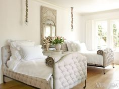To allow forms and textures to come to the fore, the house, down to the guest rooms, is pattern-free. Napoleon III tufted beds and 18th-c. Venetian fauteuil in Bergamo Oseille Sauvage linen. The console table is the mate to the one in the guest bath.    - Veranda.com