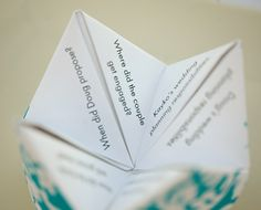 Cootie Catchers. Placed on reception dining tables as decoration and to add fun.