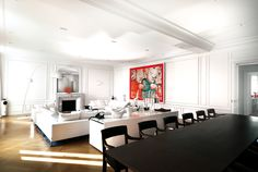 The Parisian apartment designed by Gillian Brown and Rob Wetzels. Large white Minotti sofa's, a lamp by Foscarini and speakers by B, vases by Driade, all kept company by the artwork Sweet Life 1 by Zhu Wei. The Doorknobs are made after an original Parisian design. The white chest was designed by Wetzels Brown. Photo by Hans Fonk