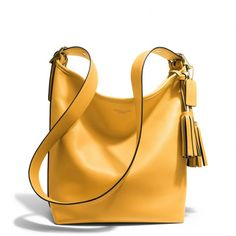 The Legacy Duffle In Leather from Coach- love this mustard color for Fall! ❤
