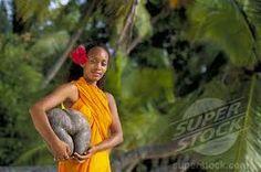 seychelles islands, woman on beach with coco de mer