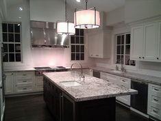 White kitchen, espresso island, bianco antico granite