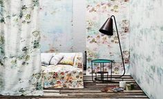 Pleasure Gardens wallcovering and cushions by Jessica Zoob.