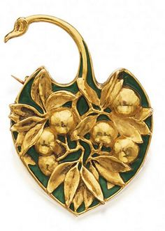 RENÉ LALIQUE. 1900 signed GOLD AND ENAMEL BROOCH. Designed as a palm leaf molded with a spray of leaves and berries against a green enamel ground. From sothebys.com