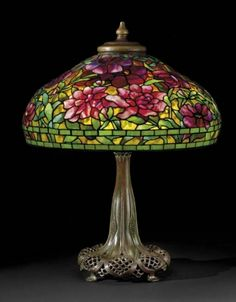 An average-size Tiffany lamp shade contains approximately one thousand glass mosaic pieces that were each hand selected and hand cut. Description from themagazineantiques.com. I searched for this on bing.com/images