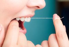 Flossing at least once a day improves your oral health by removing plaque in between teeth. Learn more about dental health today. Schedule an exam and consultation online. Dental Hygiene, Dental Health, Dental Care, Oral Health, Health Facts, Teeth Implants, Dental Implants, Dental Bridge Cost, Emergency Dentist