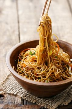 Thin egg noodles stir fried until just crisp, and then tossed with a sweet and savory soy-based sauce, crunchy bean sprouts, green onions, and carrot.